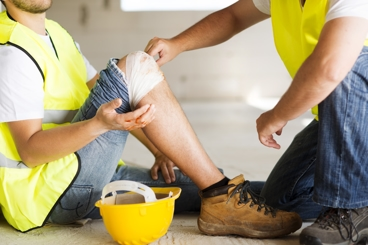 Injured Worker with Bandaged Knee